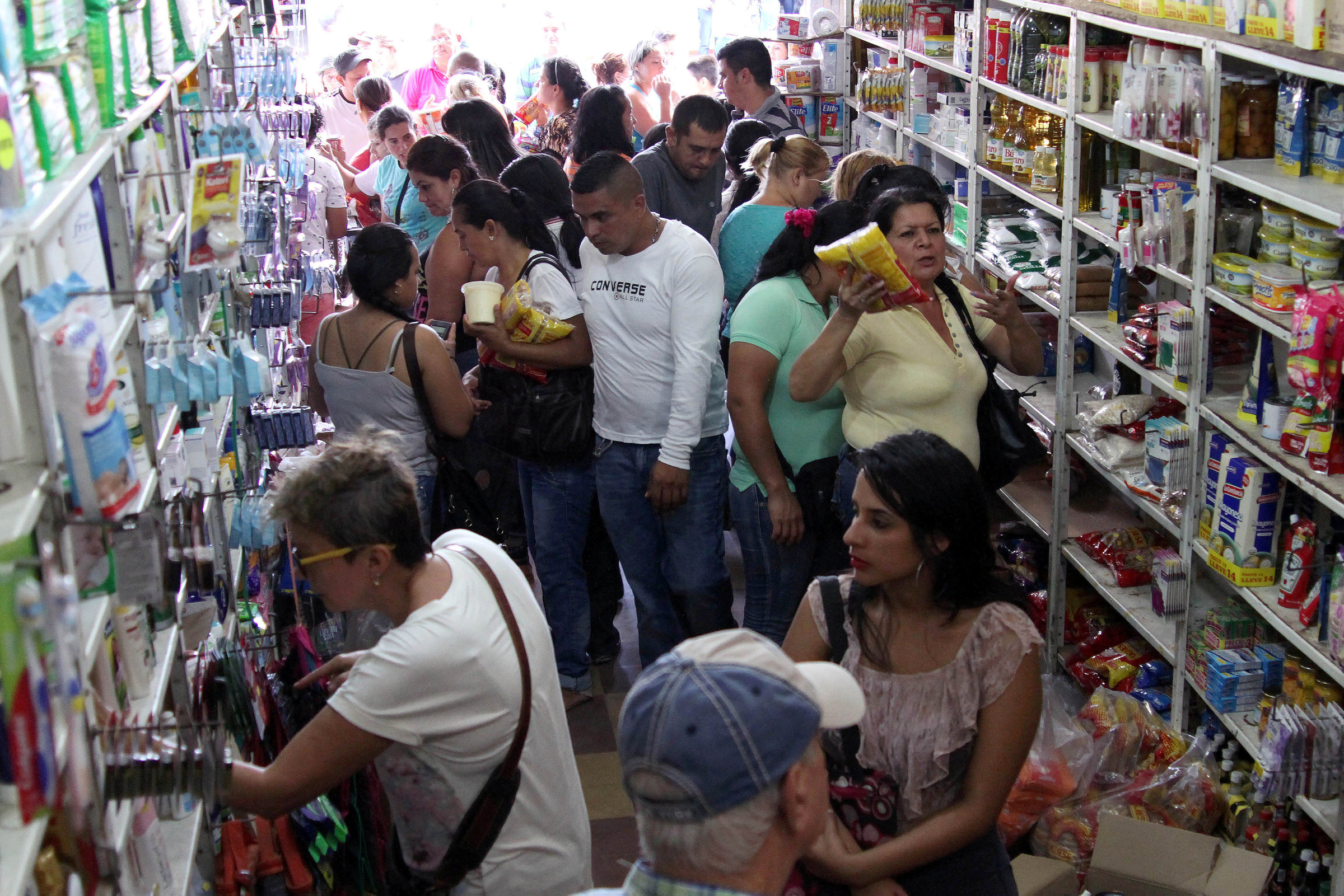 Venezuelans buy goods at a local supermarket in Cucuta, Colombia, July 10, 2016, during a temporary border opening. (CNS photo/Manuel Hernandez, Reuters)