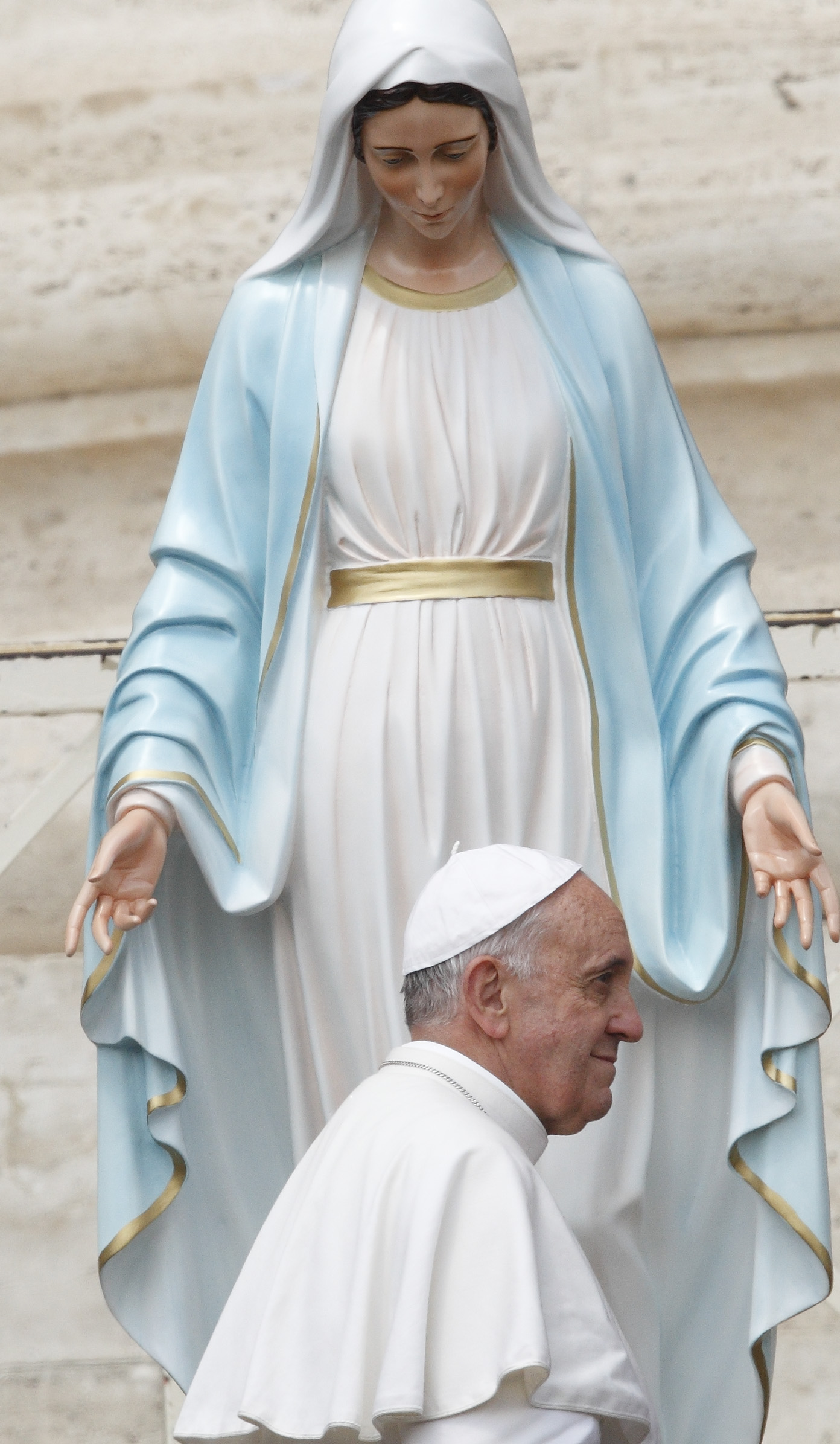 Pope Francis walks past a statue of Mary after praying in front of it during his general audience in St. Peter's Square at the Vatican, May 29, 2013. (CNS photo/Paul Haring)