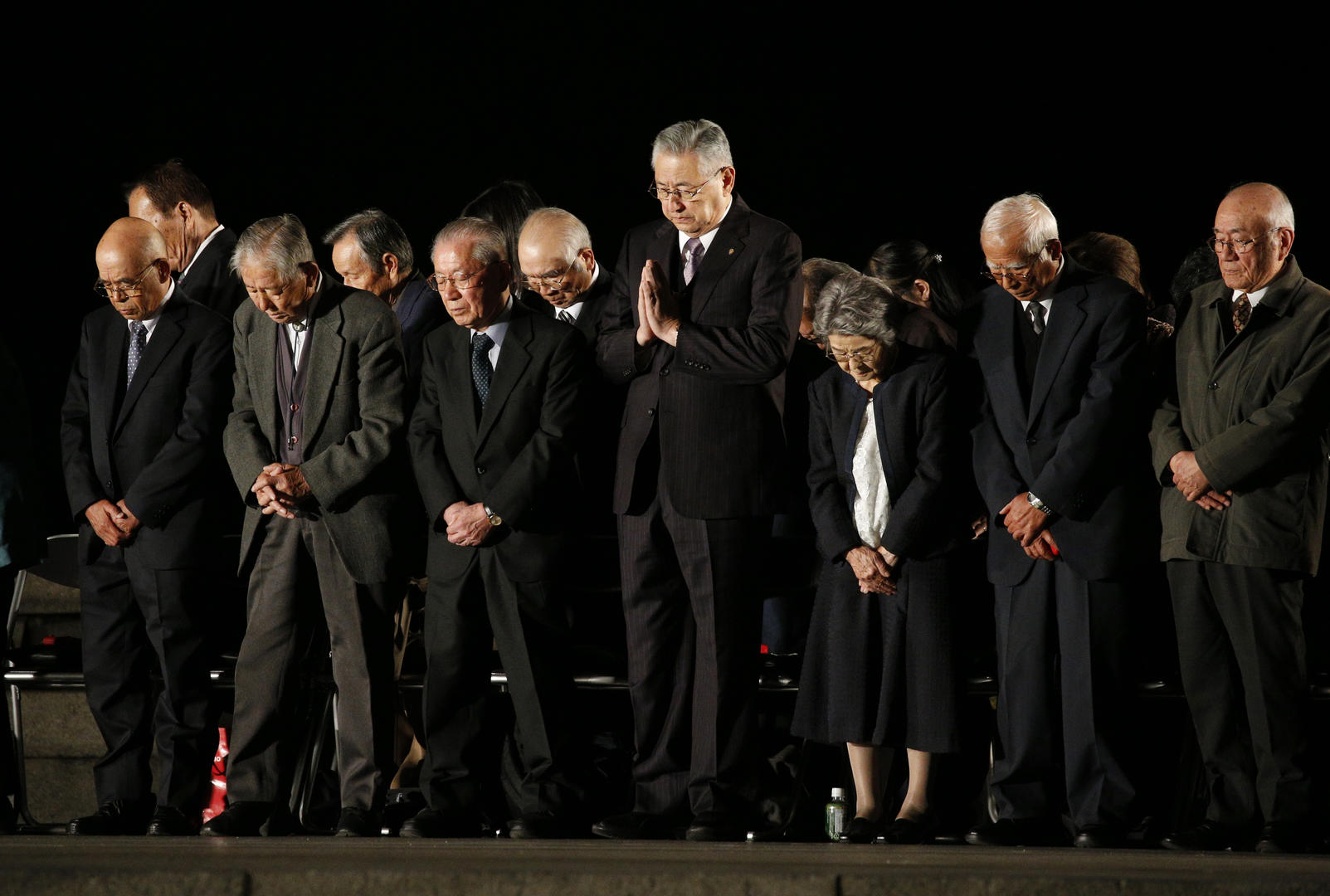 Victims of the 1945 atomic bombing observe a moment of silence during a meeting for peace led by Pope Francis at the Hiroshima Peace Memorial in Hiroshima, Japan, Nov. 24, 2019.