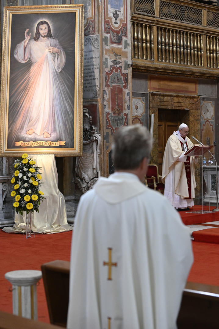 An image of Jesus of Divine Mercy is seen as Pope Francis celebrates Mass marking the feast of Divine Mercy at the Church of the Holy Spirit near the Vatican in Rome April 19, 2020. The church houses a sanctuary dedicated to Divine Mercy. (CNS photo/Vatican Media)