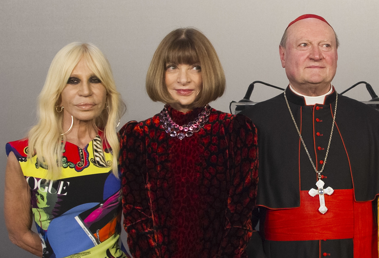 Cardinal Gianfranco Ravasi, right, designer Donatella Versace, left, and Vogue Editor-in-Chief Anna Wintour pose for photos at Palazzo Colonna in Rome. (AP Photo/Domenico Stinellis)