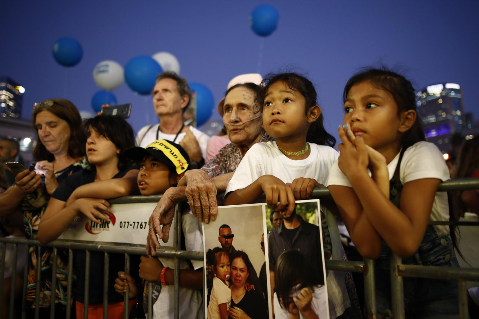 Image: People attend a rally in Tel Aviv on Aug. 6 to protest the deportations of Filipino workers and their children from Israel. (Photo: Corrina Kern)