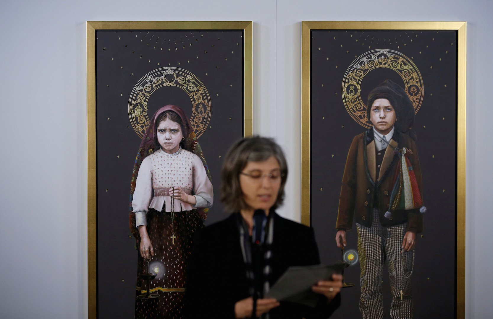Two paintings of Blessed Jacinta Marto and Blessed Francisco Marto are presented during a May 8 news conference in Fatima, Portugal (CNS photo/Rafael Marchante, Reuters).