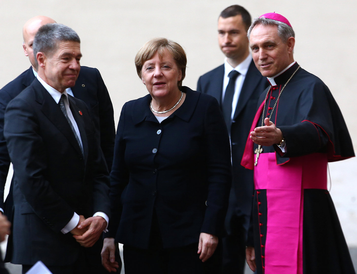 Archbishop Georg Ganswein greets German Chancellor Angela Merkel and her husband, Joachim Sauer, as they arrive March 24 for the European Union summit with Pope Francis at the Vatican (CNS photo/Alessandro Bianchi, Reuters).