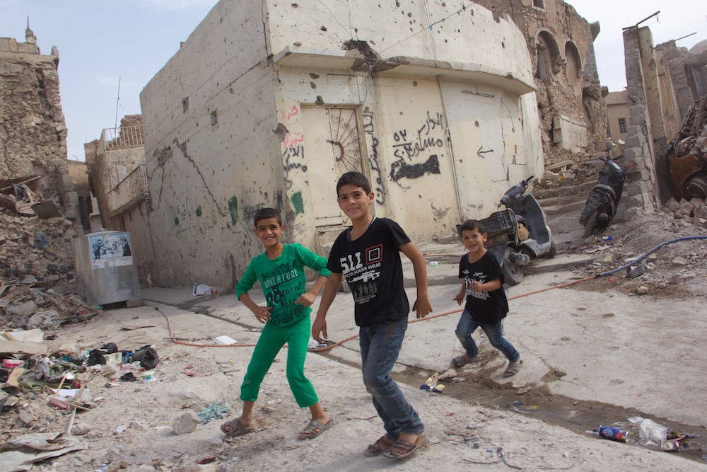 Image: Children find a way to play anywhere, even in the ruins of West Mosul.