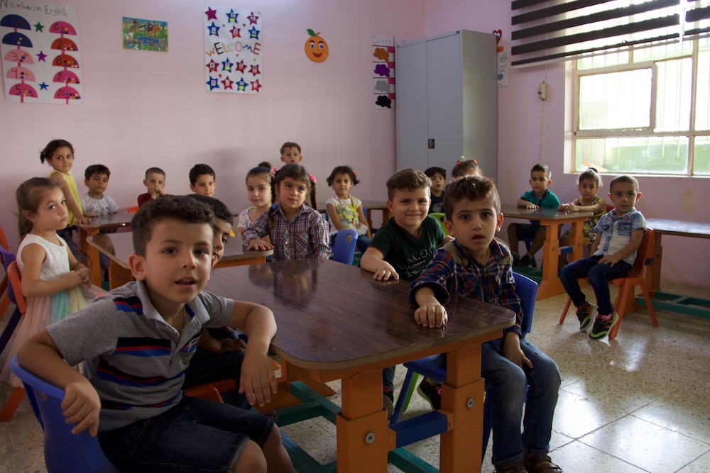Image: These children at a kindergarten supported by Jesuit Refugee Service in Qaraqosh are a small sign of life in a Christian city that had been completely devastated by ISIS occupation.