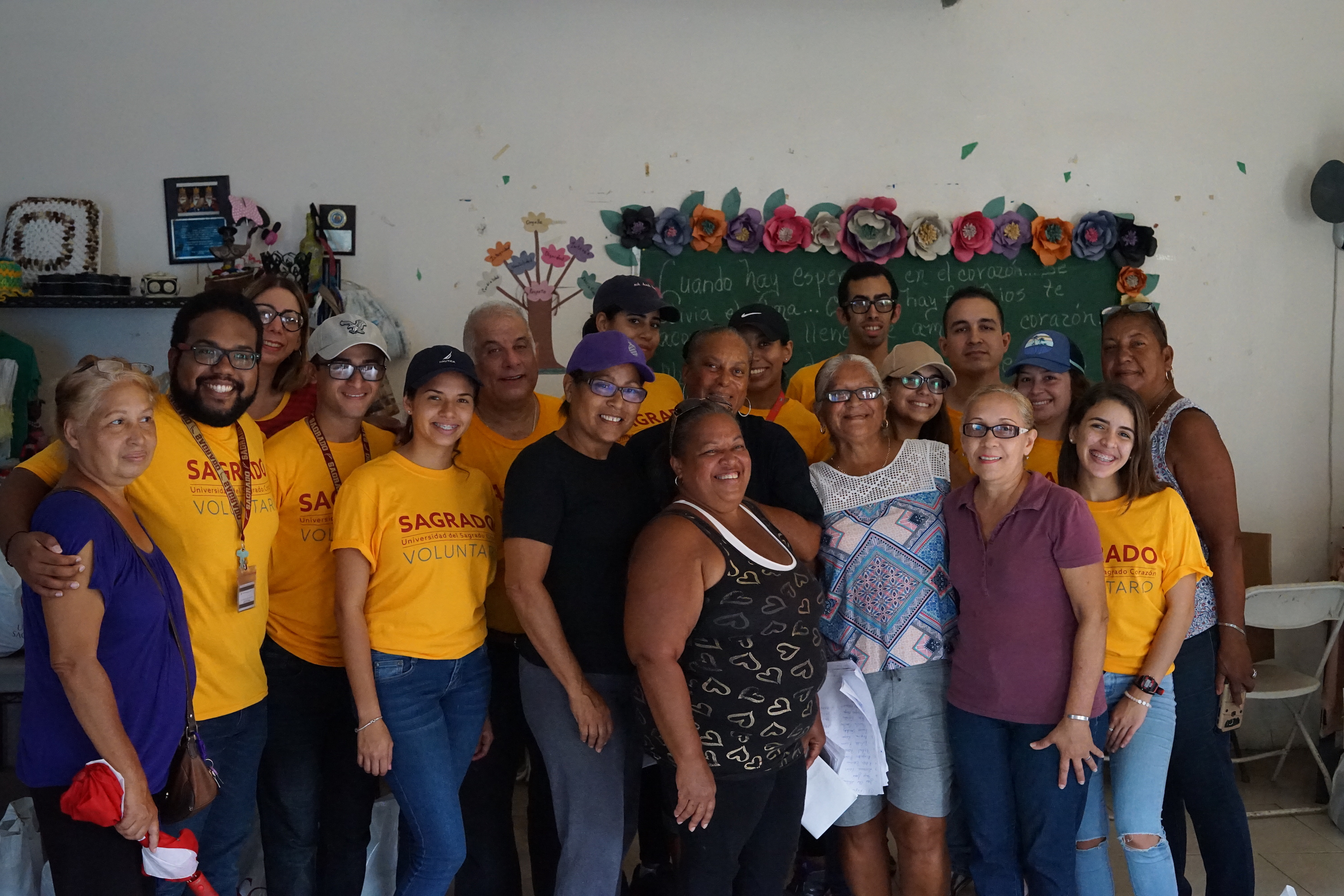 Students and community leaders pose for a photo after distributing aid in las Playitas.