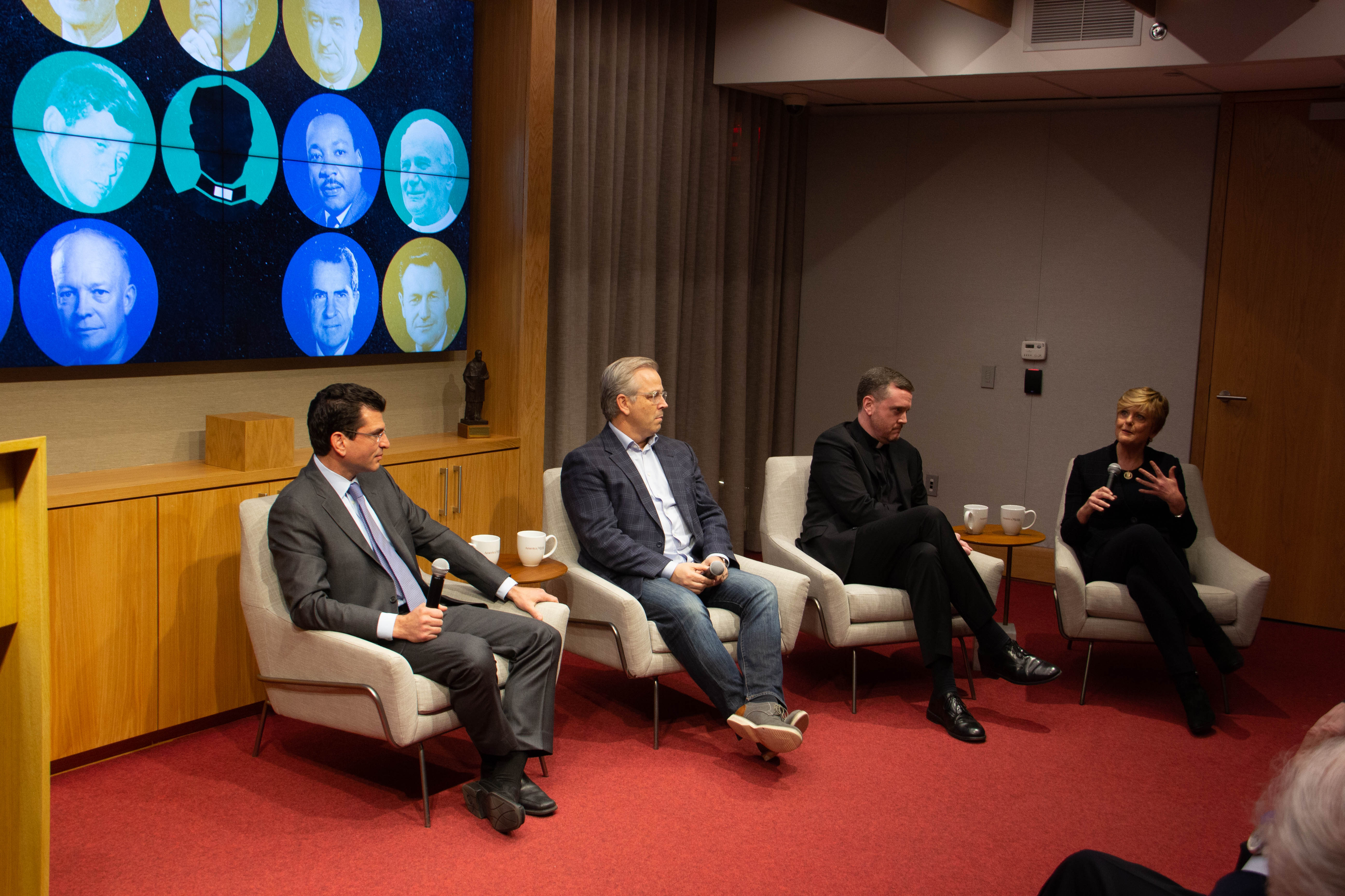 "Jason Grumet, Patrick Creadon, Matt Malone, S.J., and Anne Thompson at the screening of ""Hesburgh"" at America Media's headquarters in New York"