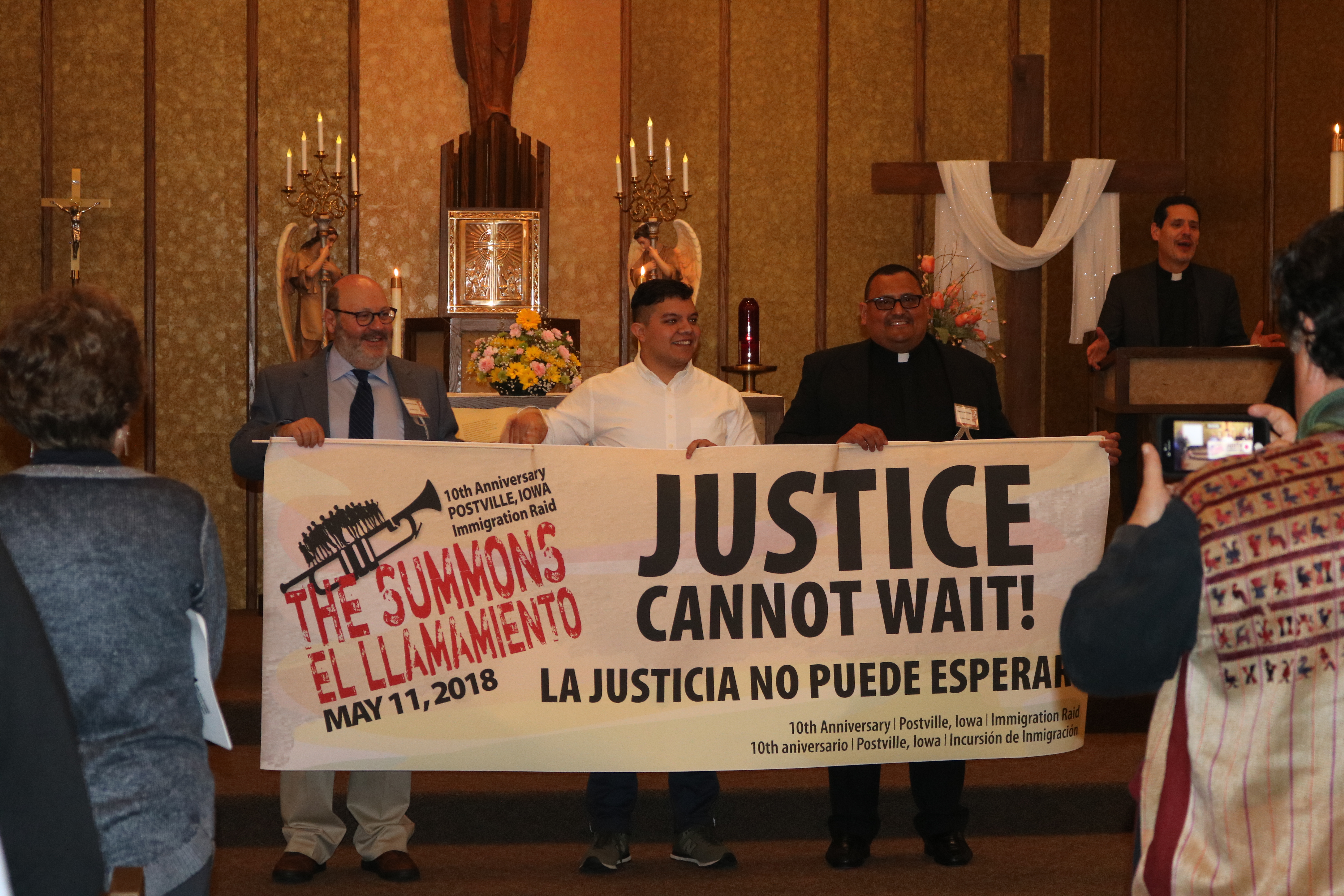 "Activists at ""The Summons,"" the interfaith gathering commemorating the Postville immigration raid."
