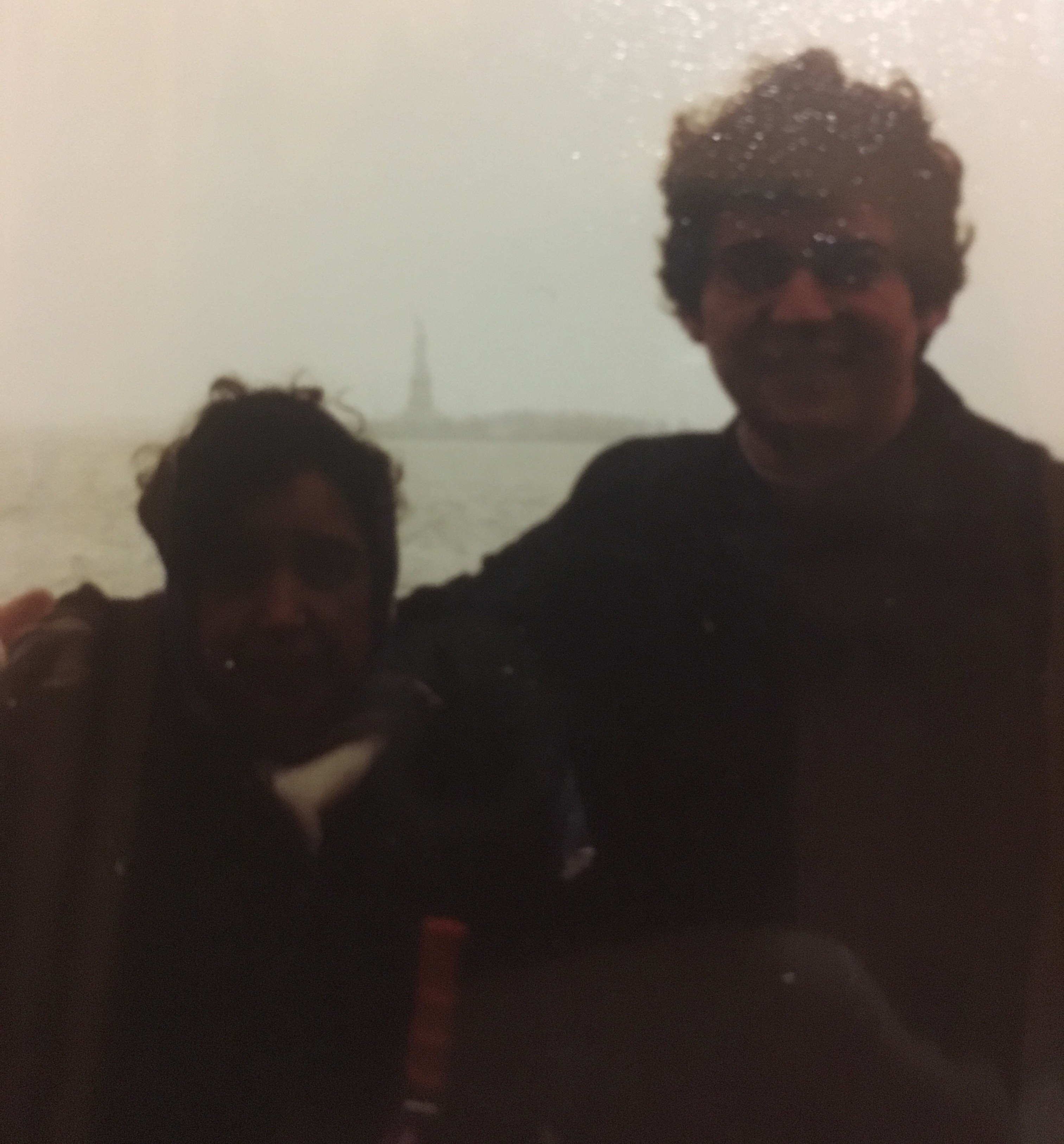 My grandmother and father at the Statue of Liberty in the early 1990s. My dad did not come to the United States by way of the New York Harbor. Nevertheless, to me, this picture still represents that he made it and that through his immigration story my own (still unborn) life as an American began.