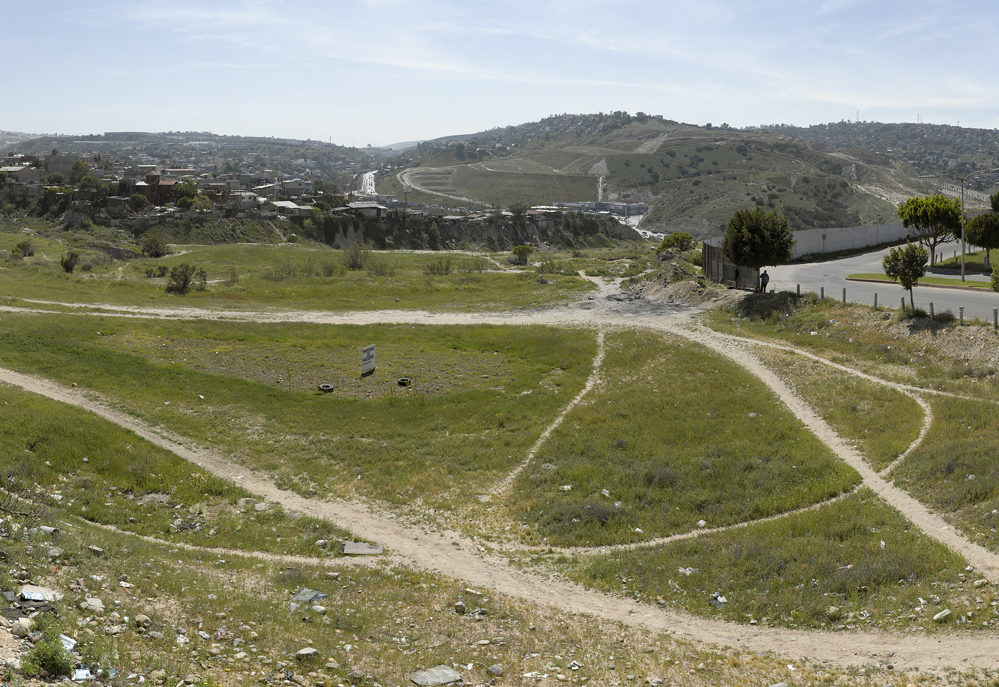 Tijuana residents have worn paths through a vacant patch of grass in this border city. (David Taylor)
