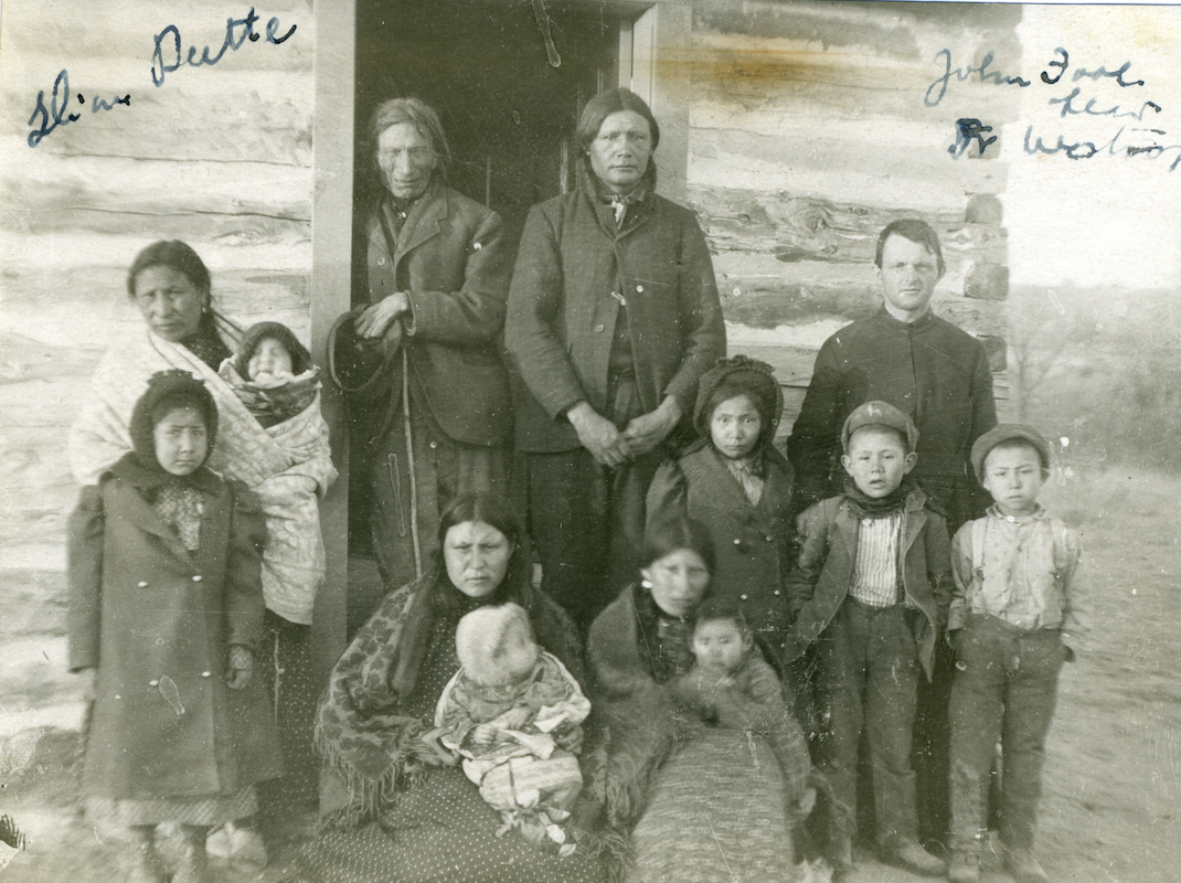 Henry Westropp, SJ, visiting John Fool Head and his family, nd, 1890-1920, Slim Buttes, S. Dak.