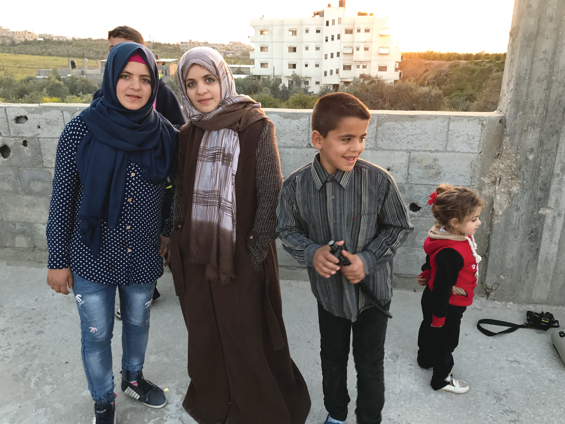 The Husam Family lives directly in the flight path of Israeli rockets. (America Media staff)