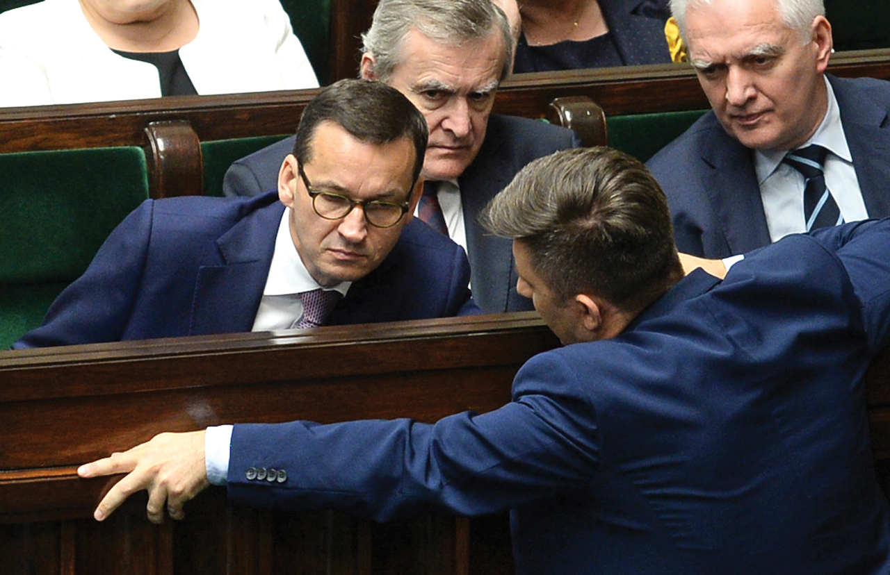Polish Prime Minister Mateusz Morawiecki, left, during a parliament debate on changes to a controversial Holocaust law, Warsaw, June 27. (AP Photo/Alik Keplicz)