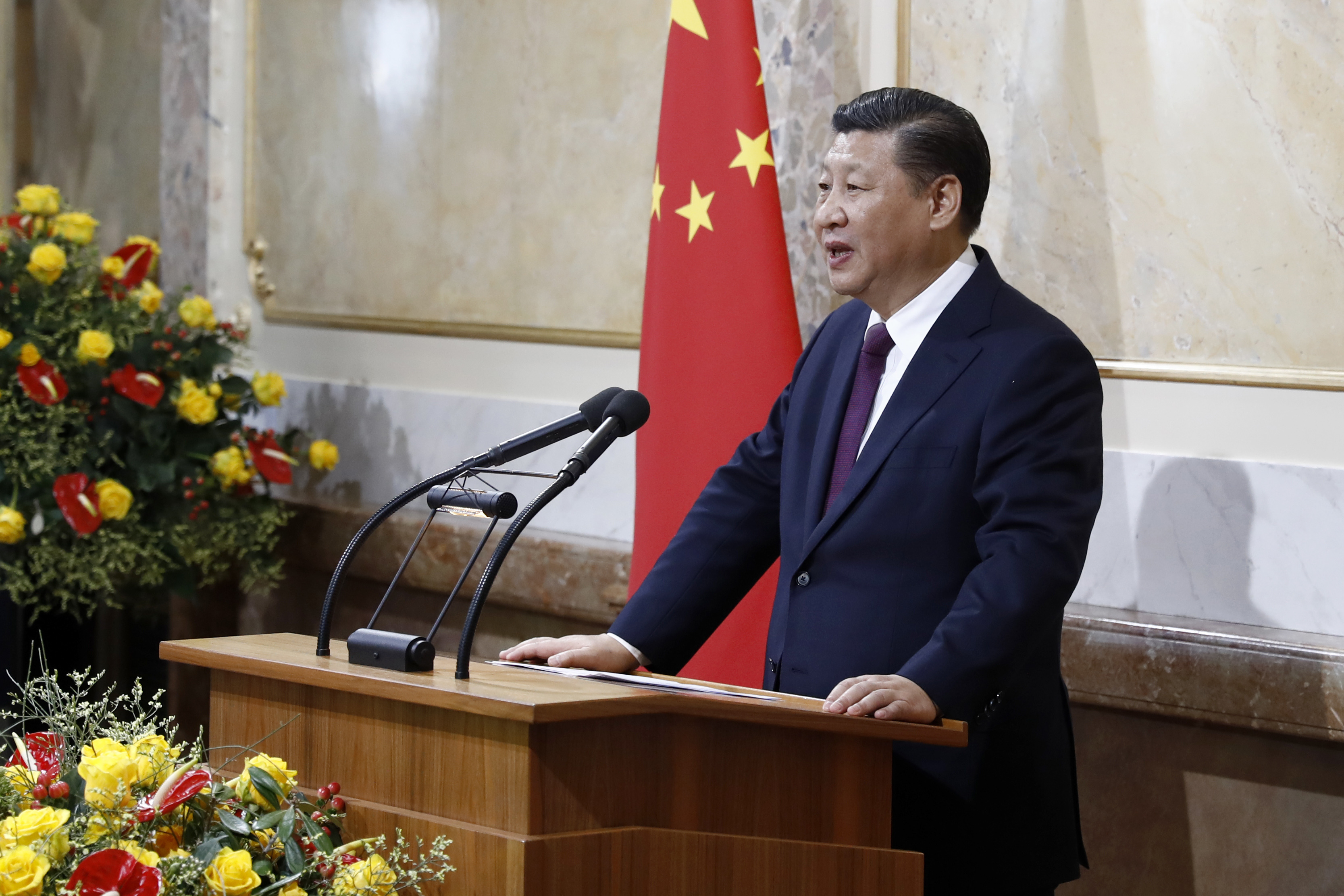 China's President Xi Jinping speaks in the house of parliament during his two days state visit to Switzerland, in Bern, Switzerland, on Sunday, Jan. 15, 2017. (Peter Klaunzer/Pool Photo via AP)