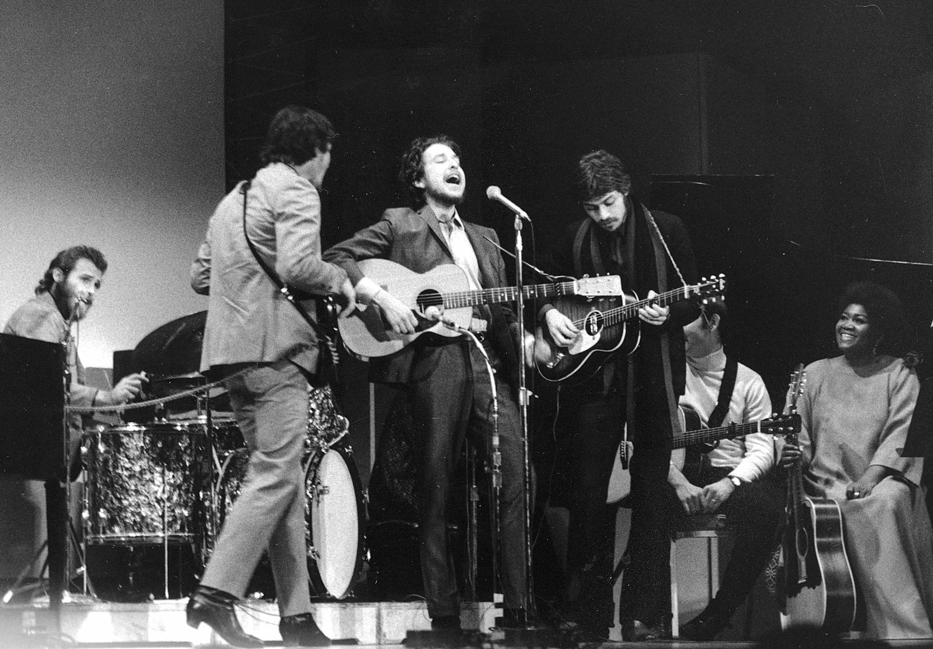Bob Dylan, center, performs with drummer Levon Helm, left, Rick Danko, second left, and Robbie Robertson of The Band at Carnegie Hall in New York City on Jan. 20, 1968. The concert was part of a benefit tribute to the late folk singer-songwriter Woody Guthrie (AP Photo).