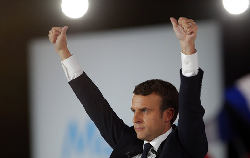 French independent centrist presidential candidate Emmanuel Macron waves to his supporters during a campaign rally in Paris, France, Monday, May 1 (AP Photo/Christophe Ena).