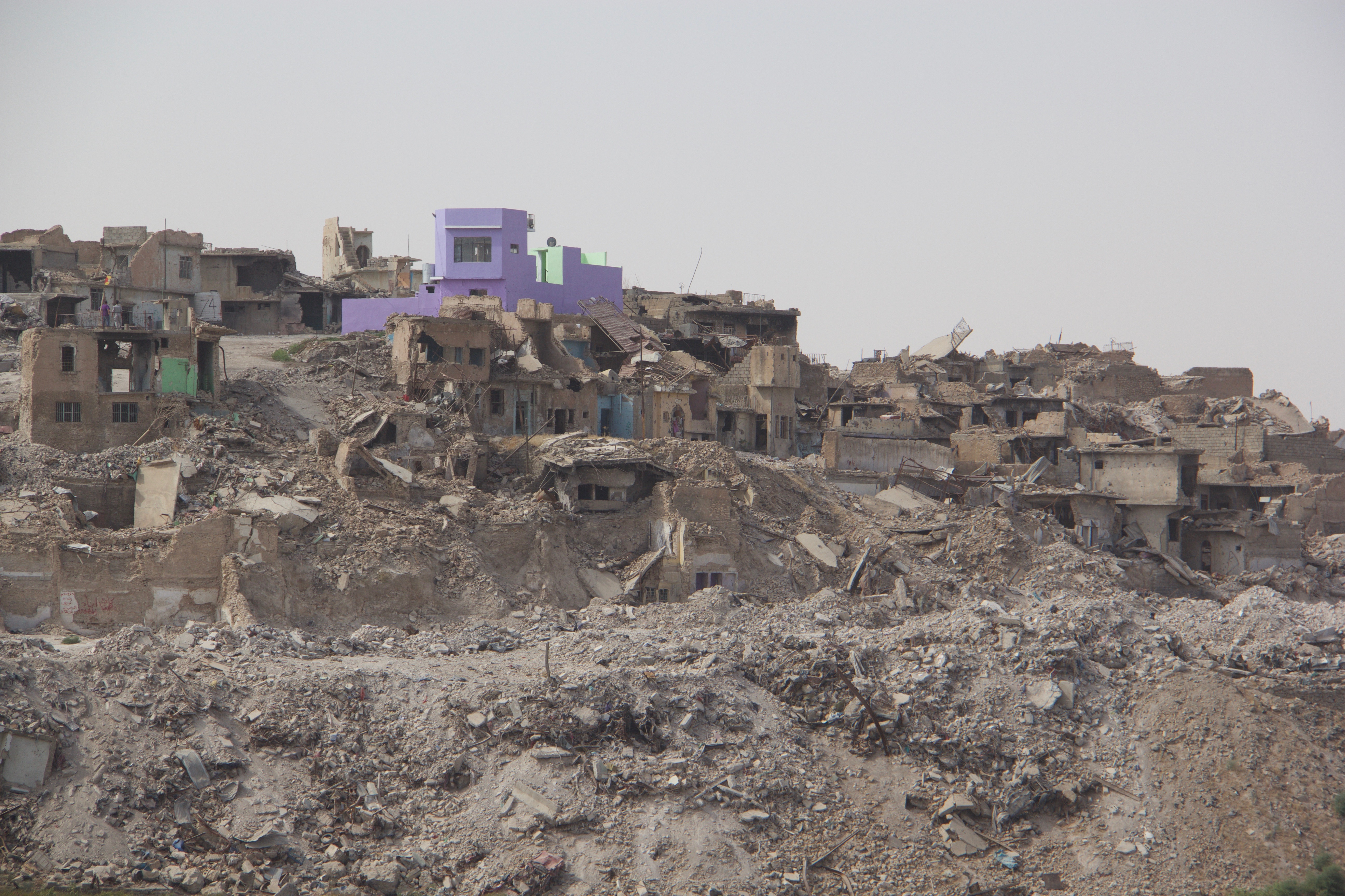 Image: One fan of the color purple has restored a house in the otherwise devastated Old City of Mosul. (Kevin Clarke)
