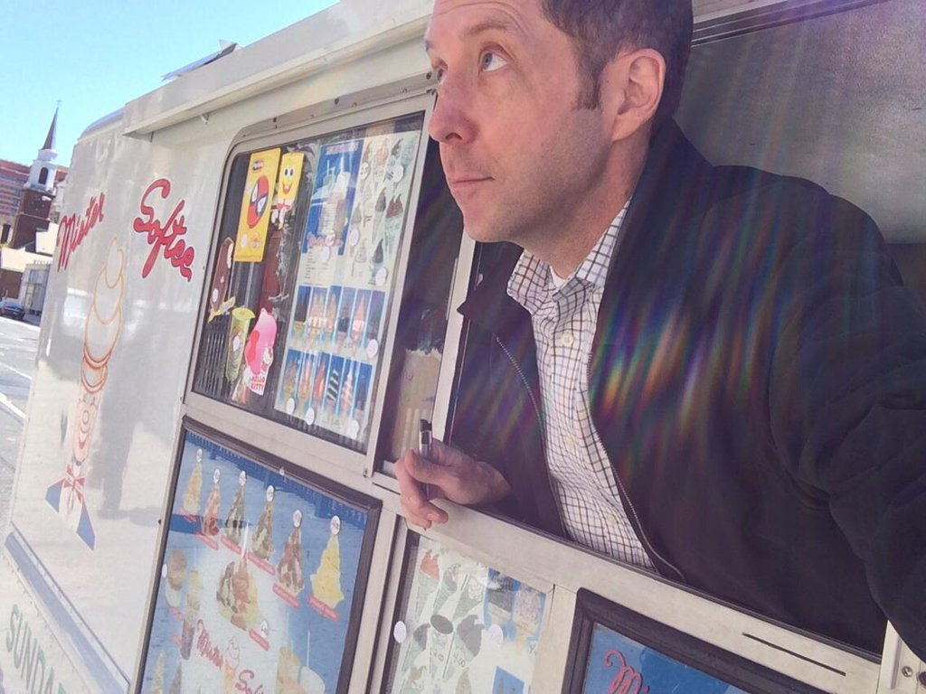 A selfie of Wilson reporting a column on turf wars between ice cream truck drivers.