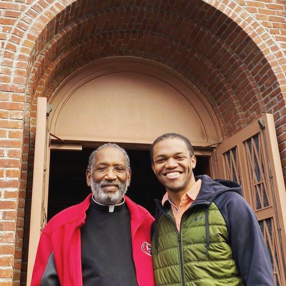 Nate Tinner-Williams with his parish priest