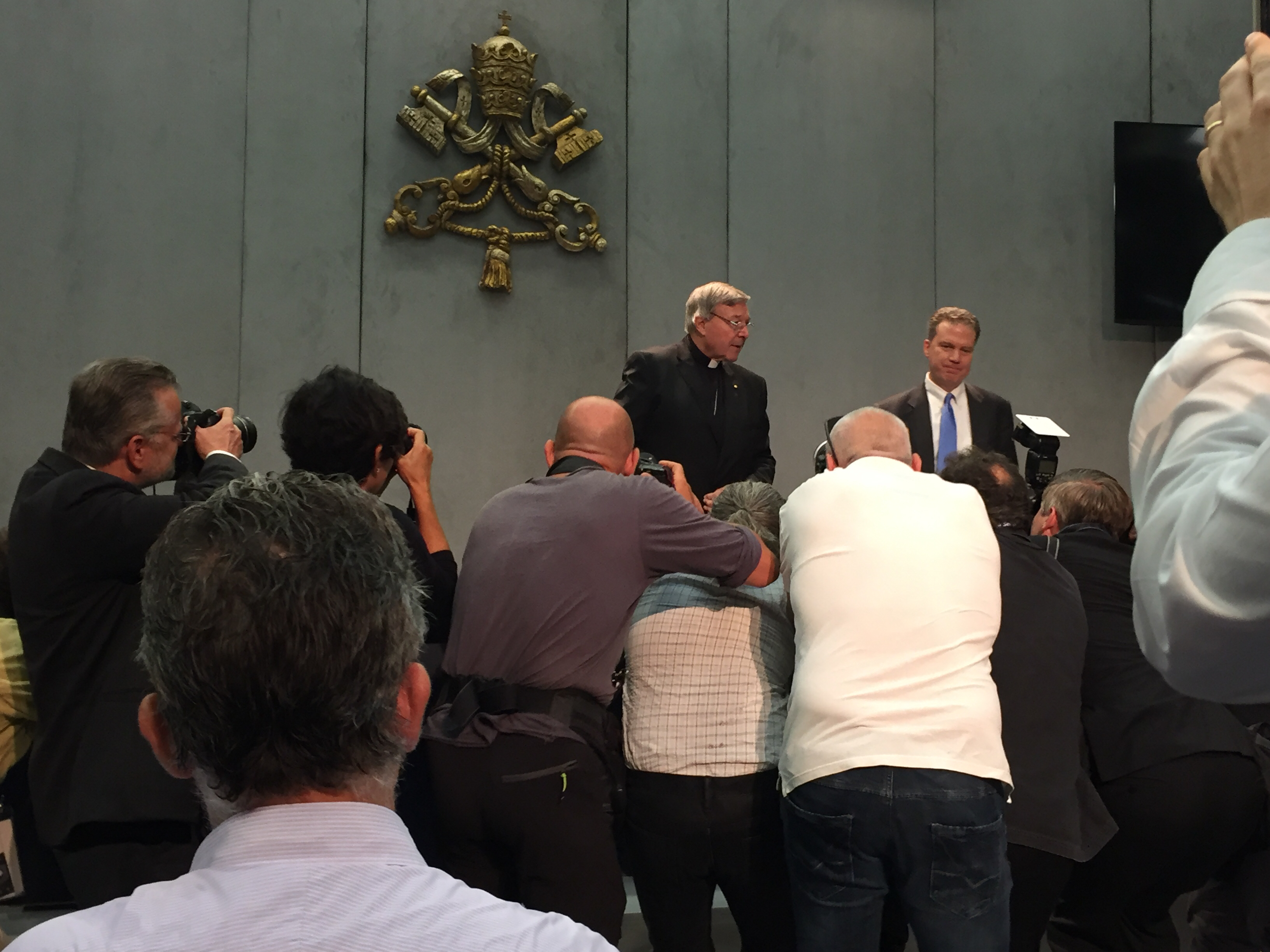 Cardinal Pell and Greg Burke speaking to the press (photo by author)