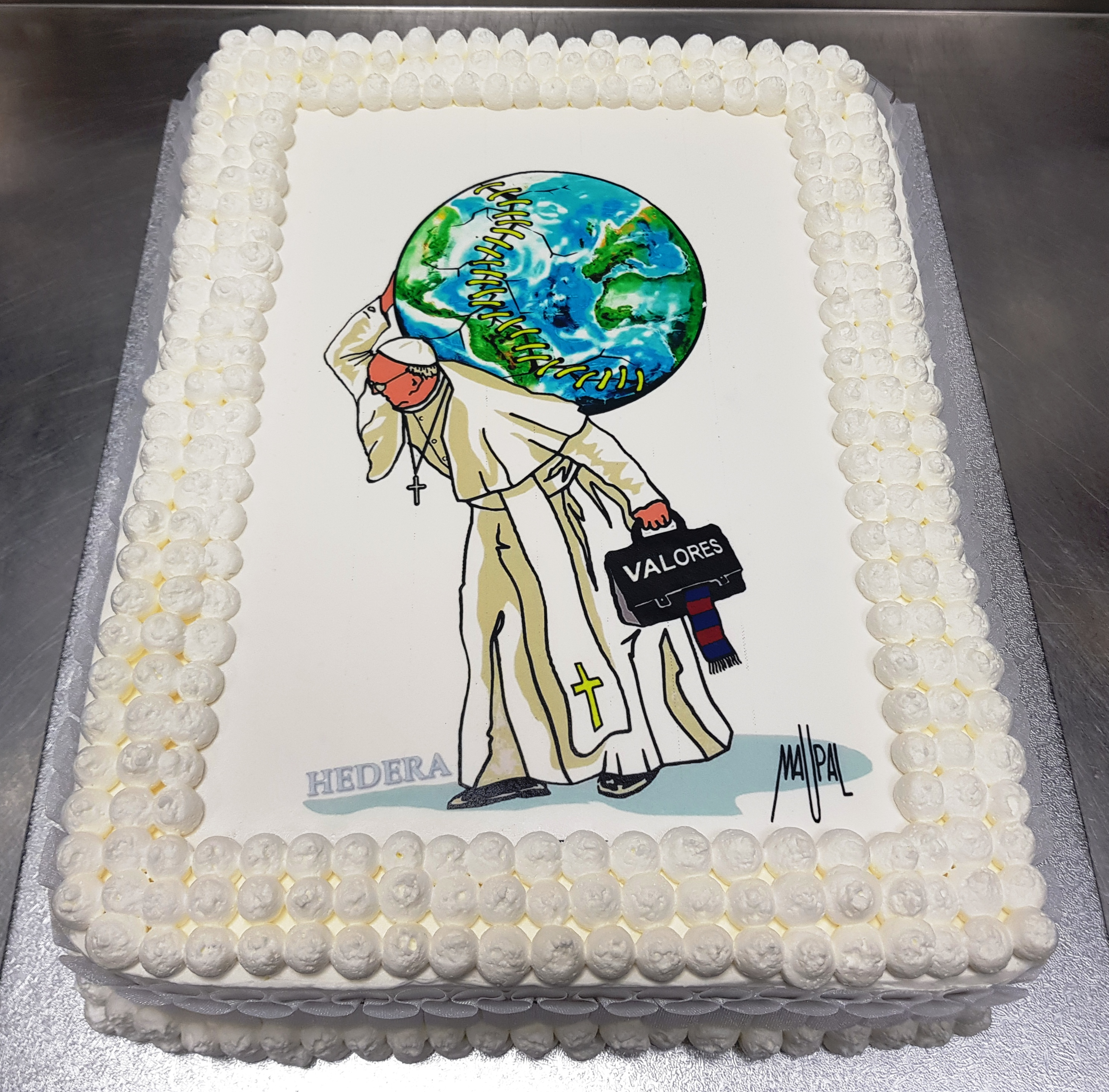 A birthday cake made by Hedera, a baker near the Vatican, with a design by the famous Roman street artist, Maupal