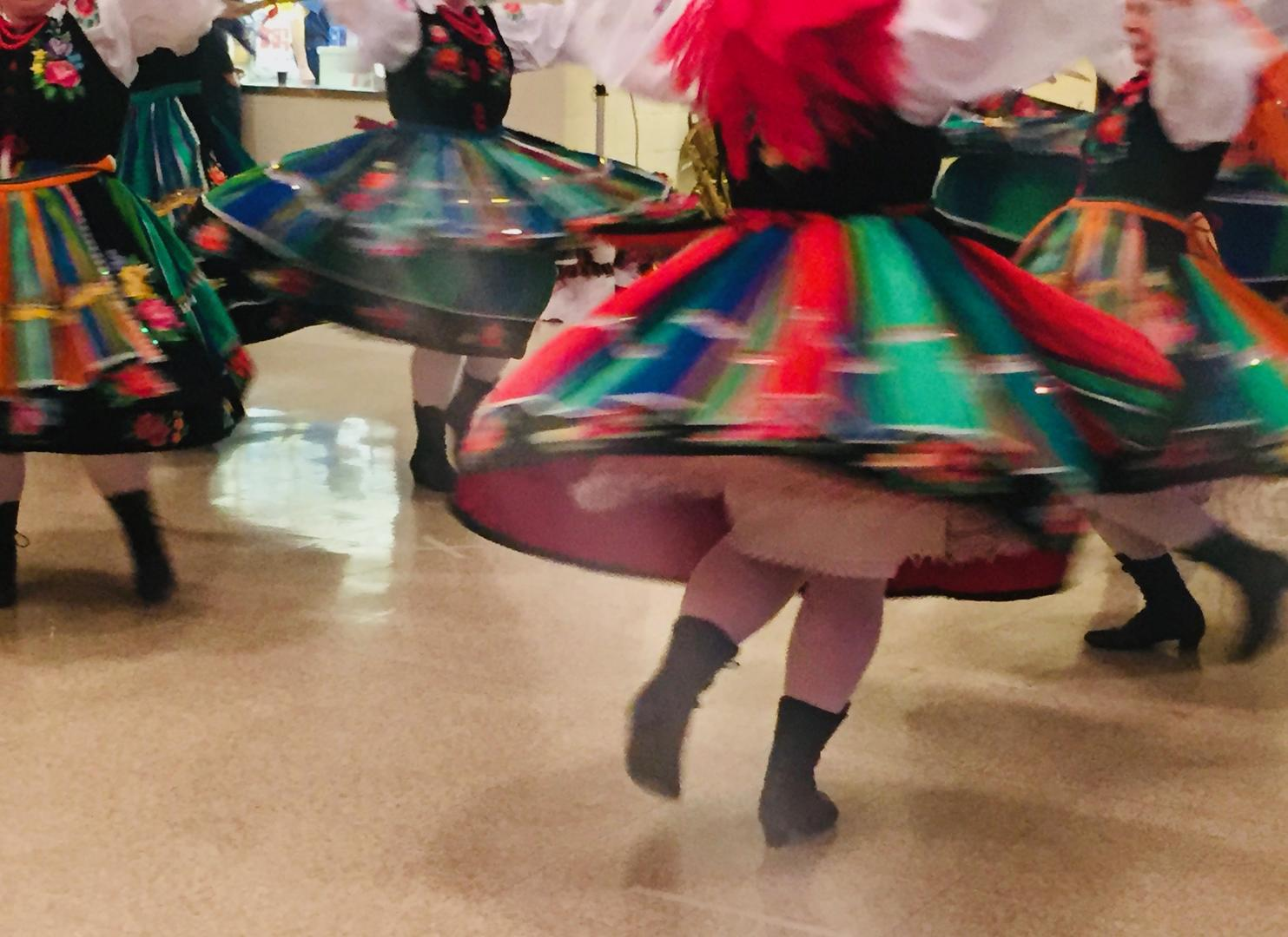 Girls in folk costumes dance at the 22nd annual paczki celebration at Holy Mother of the Rosary Cathedral in Lancaster, N.Y.