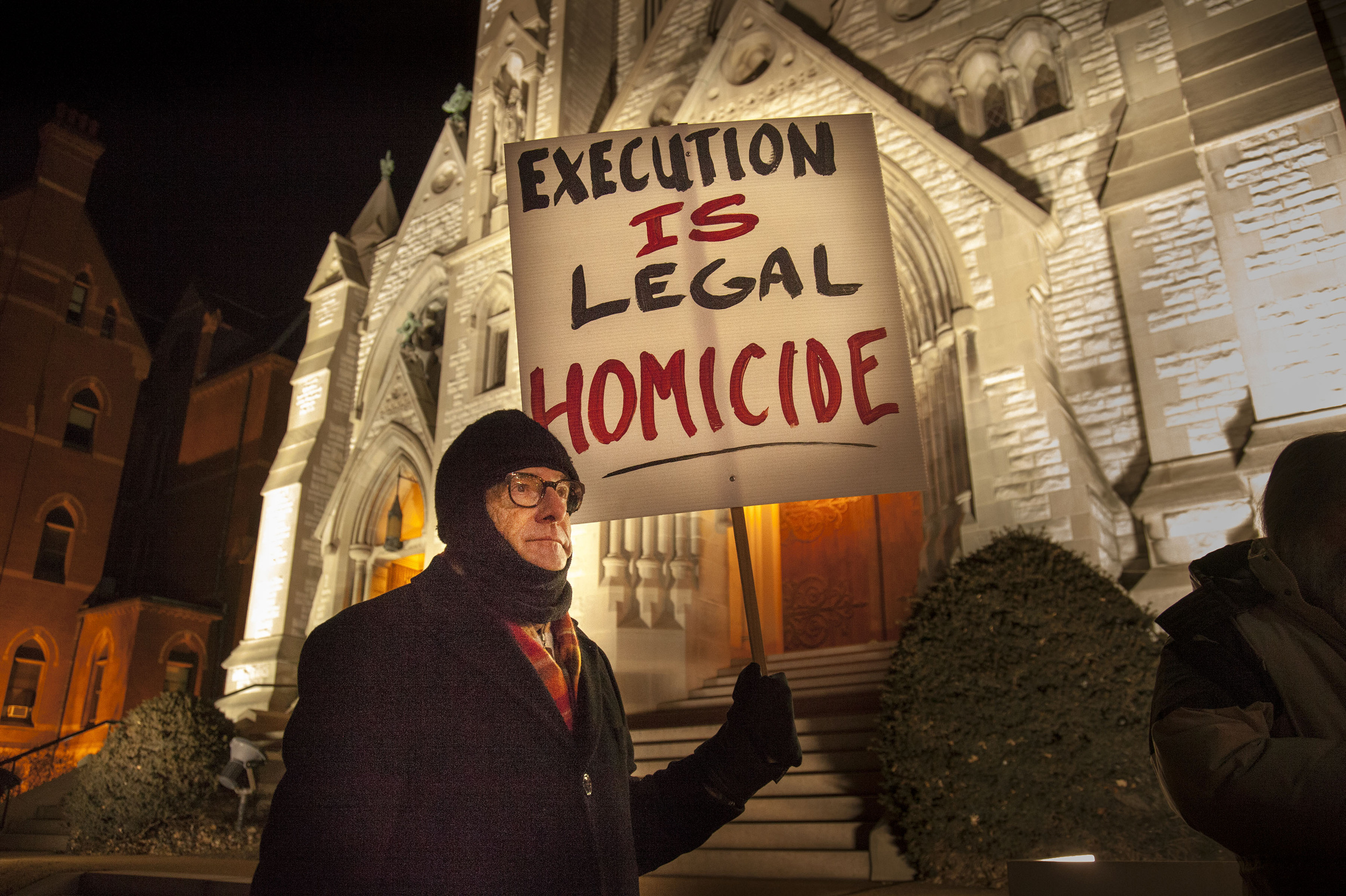 national catholic journals unite capital punishment must end man holds sign at vigil outside st louis university college church ahead of execution of