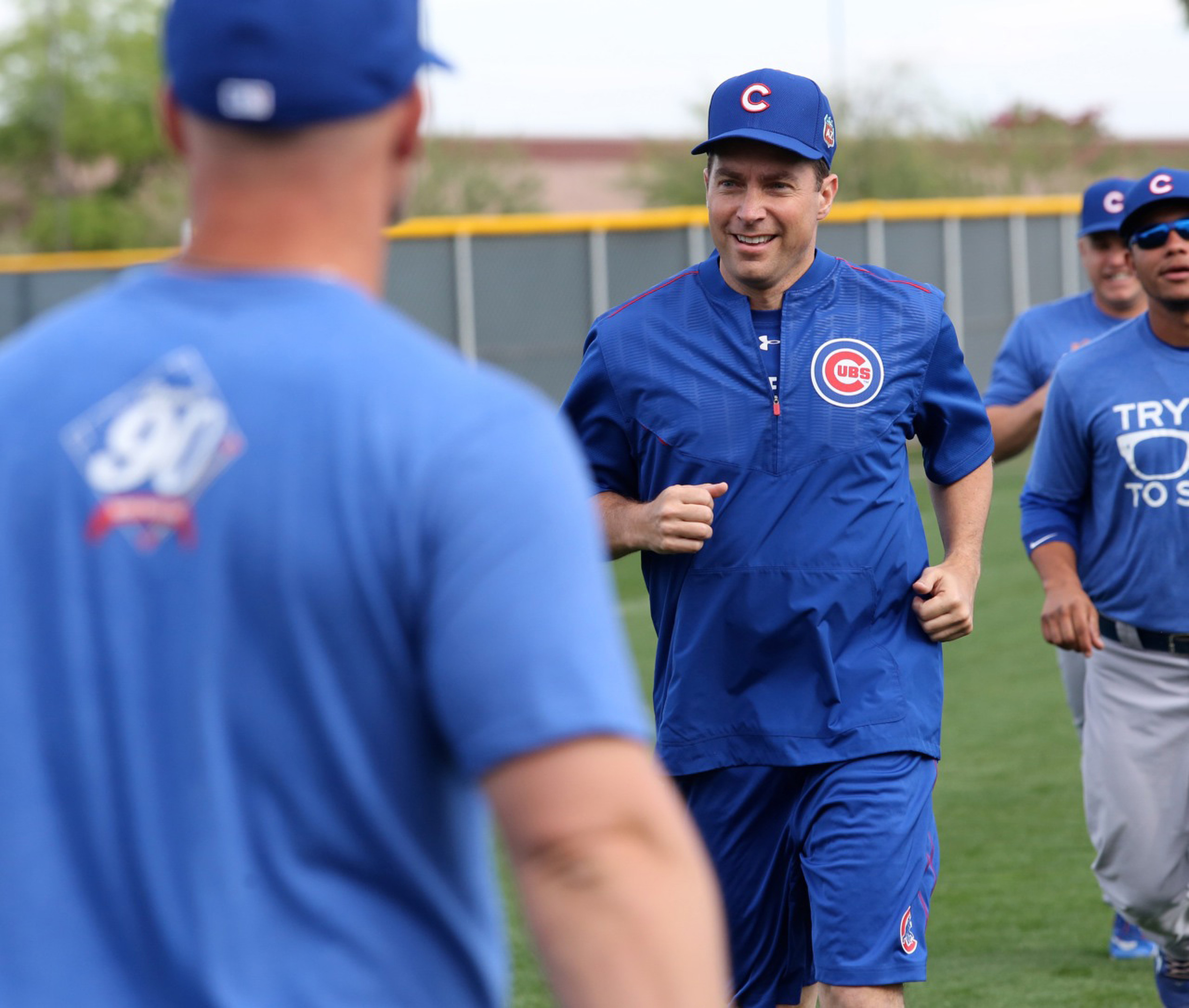 8777024d Father Burke Masters, Chicago Cubs' chaplain, takes part in a practice with  players