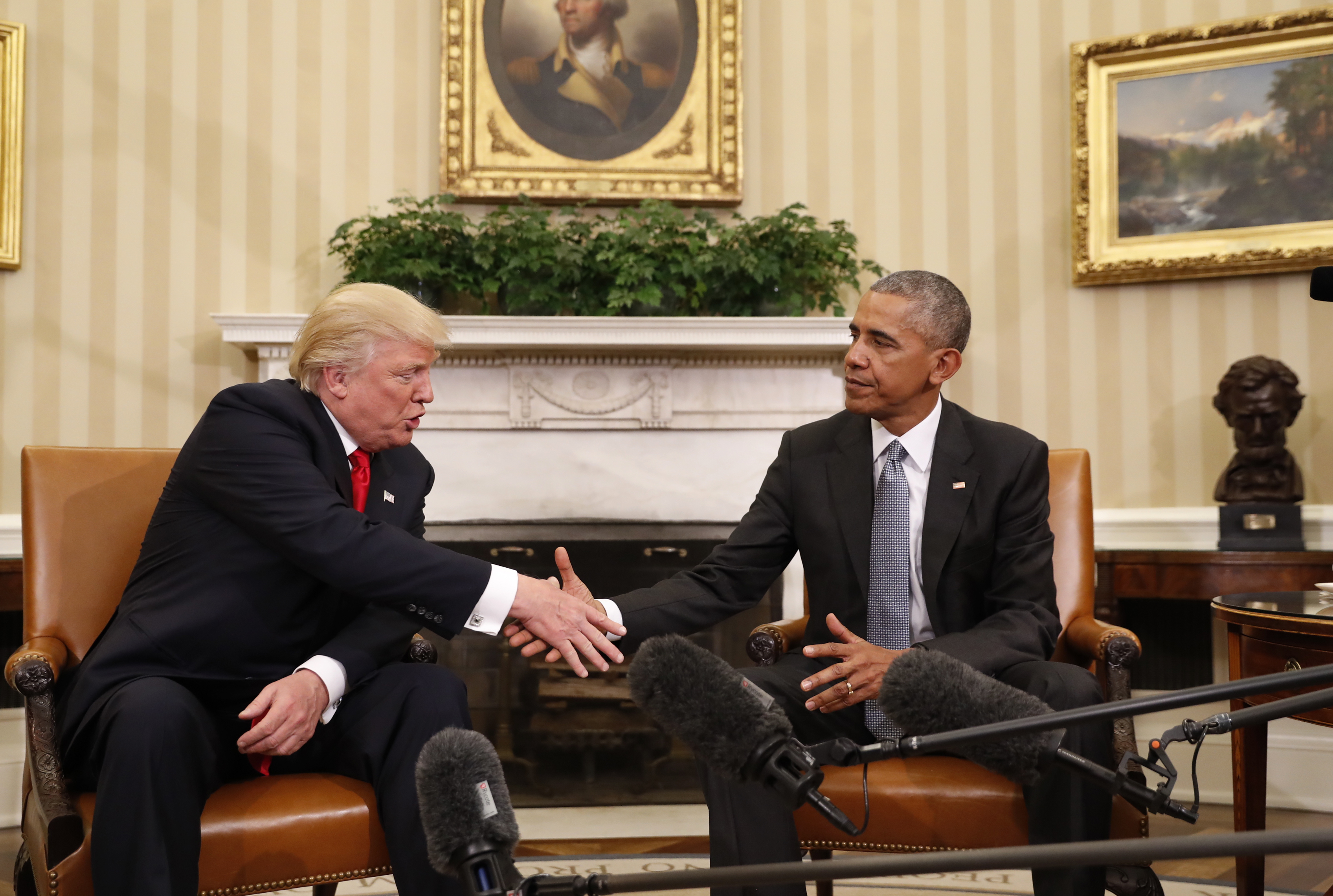 president in oval office. President Barack Obama Shakes Hands With President-elect Donald Trump In The Oval Office Of N