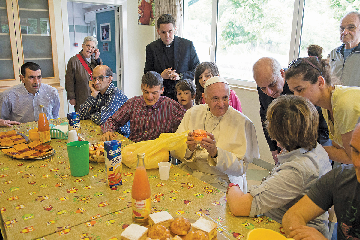 TABLE SERVICE. Pope Francis visits the Il Chicco community, part of the L'Arche movement, in Ciampino, Italy.
