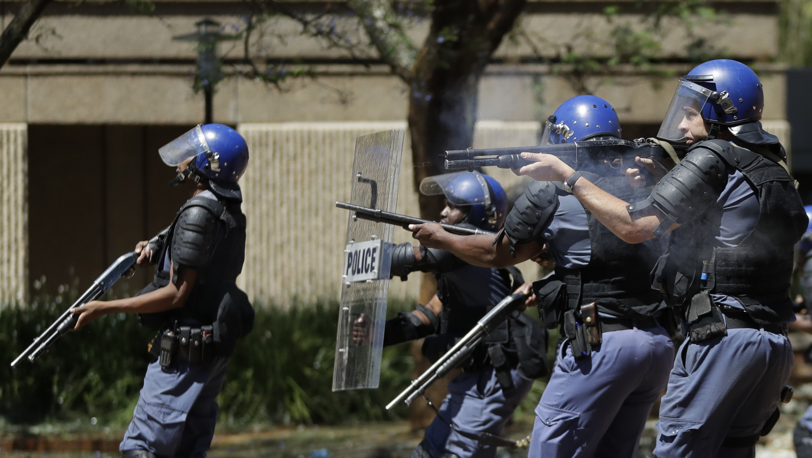 south africa still wounded after the Paramedics attend to a wounded man after attackers entered a mosque in  verulam on thursday [south african police services via ap.