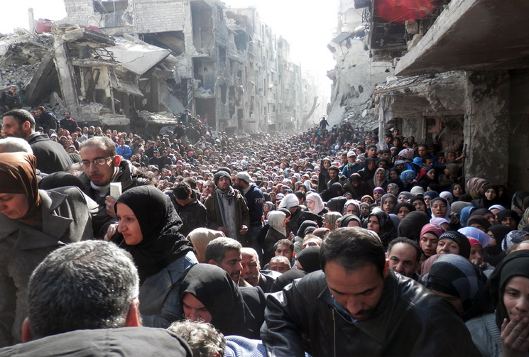 Thousands line up for 450 food parcels; 100 die each day at Yarmouk