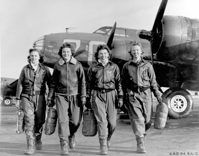 Four female pilots, part of the WWII-era Women Airforce Service Pilots program (WASP), in front of a B-17 Flying Fortress. (US Air Force photo)