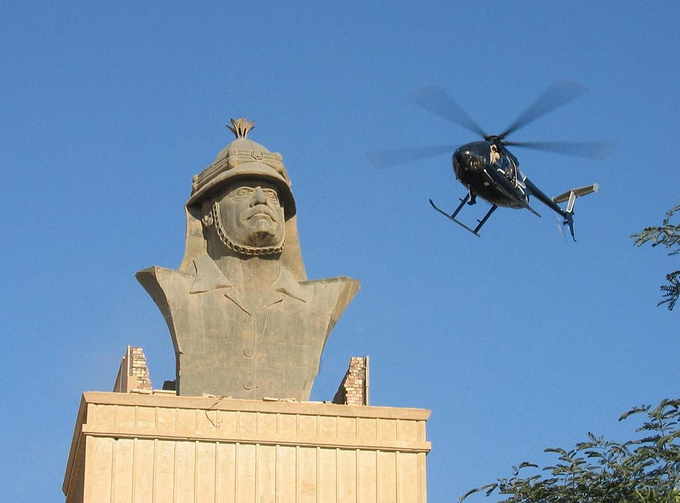 Blackwater Little Bird over Republican Palace, Baghdad (Photo via Wikimedia Commons)