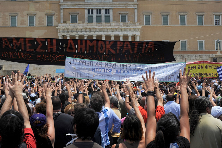Anti-austerity demonstration in front of the Greek parliament (Photo via Wikimedia)