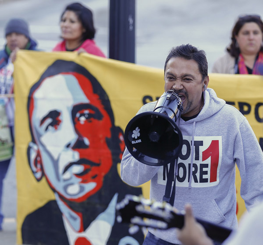 Tomas Martinez shouts into a megaphone during an immigration reform rally at the Atlanta City Detention Center in Atlanta Nov. 21. The year 2014 brought potentially significant changes for millions of people who are in the United States illegally. (CNS/EPA)