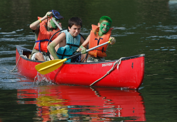 Boys compete in a canoe event at Camp Alvernia in Centerport, N.Y., the longest-running Catholic summer camp in the country. (CNS photo/Gregory A. Shemitz, Long Island Catholic)