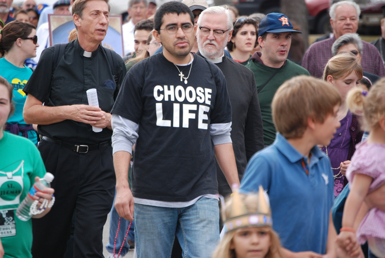 People march in protest of the death penalty and abortion in Texas. (CNS photo/Erik Noriega, Texas Catholic Herald)