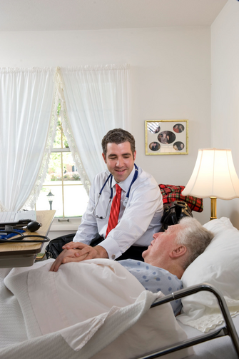 Doctor Talks with Senior Patient at Ohio Home. (CNS photo/Matthew Barrick)