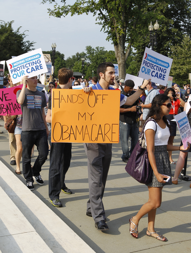 Supporters of the Obama administration's health care reform law demonstrate in front of the U.S. Supreme Court. (CNS photo/Bob Roller)