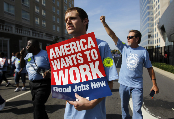 Chris Martin, center, marches with Local 5285 in a Labor Day parade ahead of the 2012 Democratic National Convention. (CNS photo/Jessica Rinaldi, Reuters)