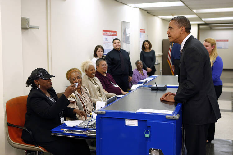 President Obama voting in 2012. (CNS photo/Kevin Lamarque, Reuters)