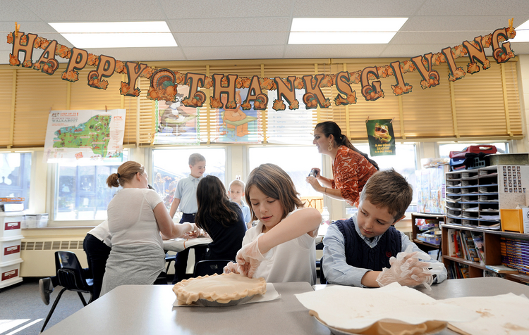 Second-grade students at St. Joseph School in Penfield, N.Y. make pies for a local soup kitchen (CNS photo/Mike Crupi, Catholic Courier)
