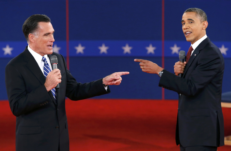 Republican Mitt Romney and Democrat Barack Obama each point out the country's biggest problem during a 2012 presidential debate.  (CNS photo/Mike Segar, Reuters)