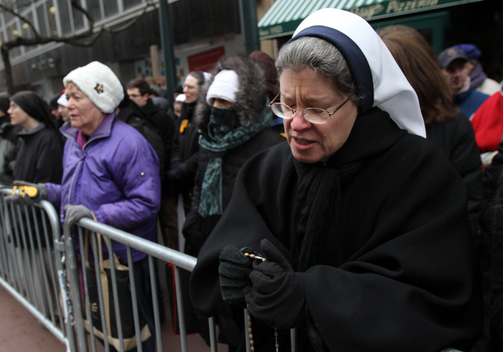 Nun prays outside abortion clinic in New York. (CNS photo/Gregory A. Shemitz)