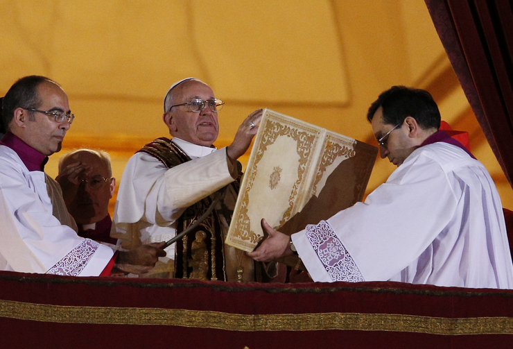 Pope Francis I delivers his first blessing from the central balcony of St. Peter's Basilica at the Vatican on March 13, 2013. Cardinal Jorge Mario Bergoglio of Argentina was elected the 266th Roman Catholic pontiff. (CNS photo/Paul Haring)