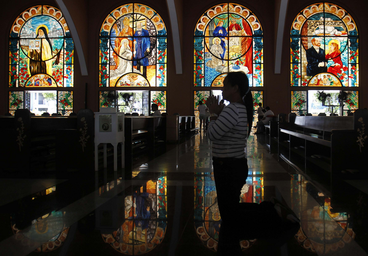 A woman prays during the Stations of the Cross on Holy Thursday at a church in Manila, Philippines, March 28. Holy Week marks a time of prayer and recalling the Passion of Jesus. (CNS photo/Cheryl Ravelo, Reuters)