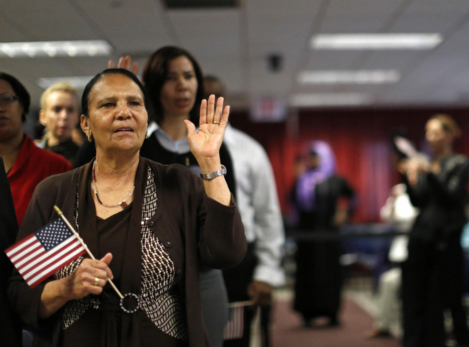 Immigrant Isabel Rivera from the Dominican Republic takes the oath of citizenship during a naturalization ceremony in New York. (CNS photo/Brendan McDermid, Reuters)