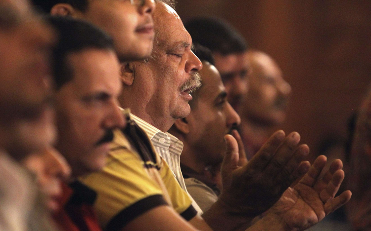 Christians pray during Coptic Orthodox Easter liturgy at main cathedral in Cairo.